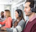 people working wearing logitech zone wireless headsets